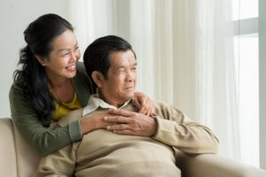 caregiver and elder looking through the window